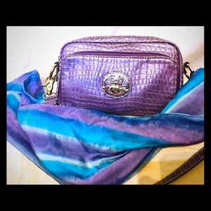 Kathy von Zeeland purple crossbody bag.